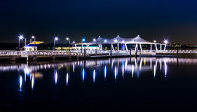 Pier reflecting in the Potomac River at night, in National Harbo Stock Images