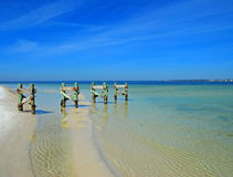 Pier Remnants in Clear Water. Pier foundation extending into clear rippled water Royalty Free Stock Photography