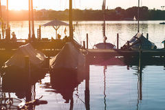 Pier with rent boat on evening on alster shortly before sunset.  Royalty Free Stock Images