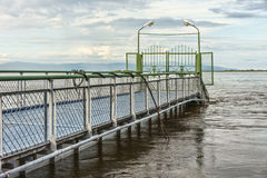 Pier on the river. Stock Images