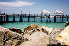 Pier and rocks. A view of a pier with rocks in the foreground Royalty Free Stock Photo