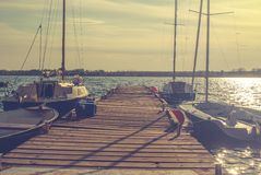 Pier with sailboats. Pier on the lake with sailboats royalty free stock photo