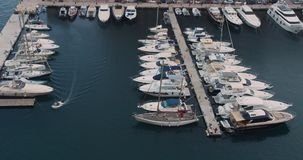 Pier sailboats. Yachts and sailboat is moored at the quay. Top view above the harbor. Pier sailboats. Yachts and sailboat is moored at the quay. Top view above stock video
