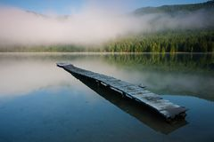 Pier in Saint Anna lake in a volcanic crater in Transylvania Royalty Free Stock Photo