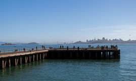 San Francisco Bay pier City view. This old military pier is now a favorite of tourists and locals alike as they look east toward the City of San Francisco Stock Photo