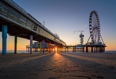 The Pier of Scheveningen. A classic view of the Pier of Scheveningen during sunset Royalty Free Stock Image