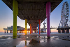 The Pier of Scheveningen. A classic view taken underneath the Pier from Scheveningen during sunset Royalty Free Stock Photo