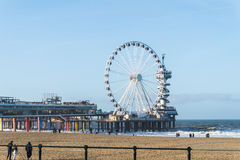 The Pier in scheveningen in the Netherlands with the beach in front Stock Photos