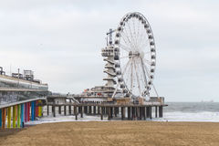 The Pier in scheveningen in the Netherlands with the Ferris wheel in the background. The beach of Scheveningen in the Netherlands Royalty Free Stock Image