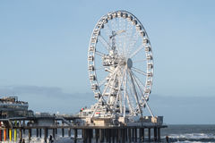 The Pier in scheveningen in the Netherlands with the Ferris wheel in front Stock Image
