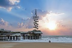 The Pier in Scheveningen Netherlands at sunset. The Pier in Scheveningen in the Netherlands at sunset Royalty Free Stock Image