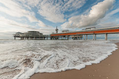 The Pier of Scheveningen. Viewed from a sand beach very close to the water, during daytime Royalty Free Stock Images
