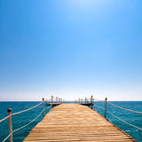 Pier in the sea and blue sky Stock Image