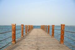 Pier on the sea. Bridge leading to the sea Royalty Free Stock Photo