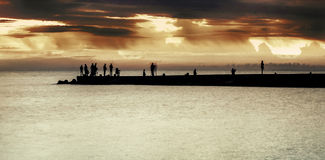 Pier. Sea pier at dark sunset Royalty Free Stock Photos