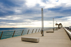 Pier, sea and dramatic sky Stock Photos