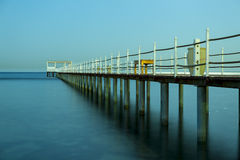 Pier in sea in Egypt. A pier leading off into the sea in Egypt stock image