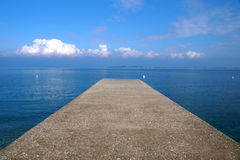 Pier on the sea horizon with a thunderstorm . Royalty Free Stock Photos