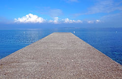 Pier on the sea horizon with a thunderstorm . Royalty Free Stock Photo