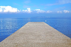 Pier on the sea horizon with a thunderstorm . Royalty Free Stock Photography