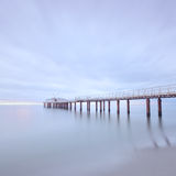 Pier sea long exposure Camaiore versilia tuscany. Modern steel pier in a cold atmosphere Long exposure photography in Lido Camaiore, Versilia, Tuscany, Italy royalty free stock image