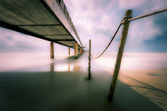 Pier at sea with long exposure Royalty Free Stock Image