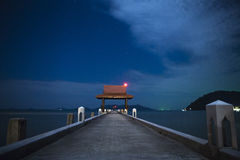Pier into the sea. Pier in the night sky Royalty Free Stock Image