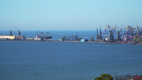 Pier sea port. Visible port cranes and ships under unloading stock video footage