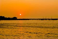 Pier and sea on silhouette at sunset. Royalty Free Stock Image