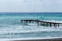 Pier in sea during storm Royalty Free Stock Photography