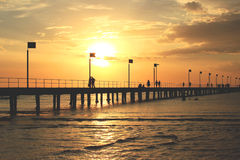 Pier, sea sunset, clouds and silhouettes Royalty Free Stock Photo