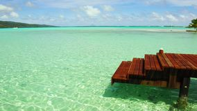 Pier in sea at tropical beach in french polynesia