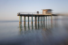 Pier in sea water Stock Photos