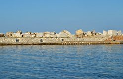 Pier at the seaside with marble blocks Stock Images