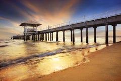 Pier shipport with sun set darmatic sky at sea beach Stock Photos