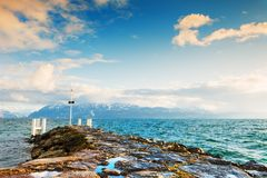 Lake Geneva in Lausanne, Switzerland. Pier on the shore of Lake Geneva in Lausanne, Switzerland Royalty Free Stock Images
