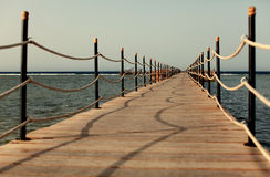 Pier on shore. Summer holiday Royalty Free Stock Photo