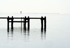 Pier silhouette. Wooden Pier on the jetty silhouette Stock Photos