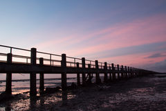 Pier silhouette. Pier bridge to sea silhouette Royalty Free Stock Photography