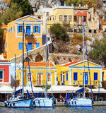 Pier Simi island with beautiful houses, similar to puppet, Aegean Sea royalty free stock images