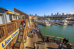 Pier 39 skyline. San Francisco, California, United States - August 14, 2016: Aerial view of San Francisco skyline from Sea Lion Center. Yachts docked at Pier 39 Royalty Free Stock Images