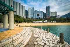 Pier and skyscrapers at Repulse Bay, in Hong Kong, Hong Kong. Stock Image