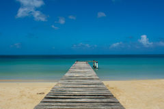 Pier. Small pier on a beach in caribbean tropical island Stock Photography