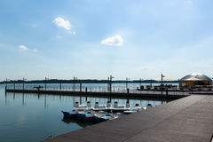Pier with small cafe. The small cafe is located on a wooden pier on the bank of the lake stock image