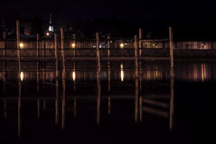 Pier in a Small Lake Front Village at Night Royalty Free Stock Photography