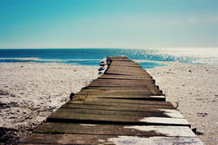 Pier in Snow. A pier in the snow leading out to the beautiful Lake Michigan waters in February. This was taken in Racine, Wisconsin Royalty Free Stock Image