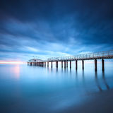 Pier soft water long exposure Lido Camaiore Versilia Tuscany Ita. Modern steel pier in a cold atmosphere Long exposure photography in Lido Camaiore, Versilia Royalty Free Stock Image