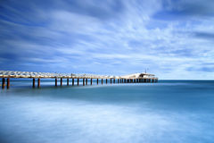 Pier soft water long exposure Lido Camaiore versilia Tuscany Ita. Modern steel pier in a cold atmosphere Long exposure photography in Lido Camaiore, Versilia Stock Images