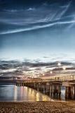Pier am Sonnenuntergang stockbilder