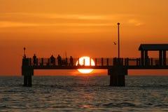 Pier-Sonnenuntergang Stockfoto
